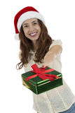 Christmas woman giving a christmas gift Stock Photography