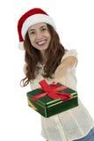 Christmas woman giving a christmas gift Stock Photography
