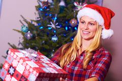 Christmas Woman Giving Gift Stock Images
