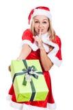 Christmas woman giving present Stock Photography