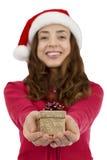 Christmas woman giving a small shiny gift box Stock Photography