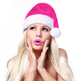 Christmas Woman. Glamour Surprised Blonde Girl in Hot Pink Hat Royalty Free Stock Photography