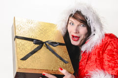 Christmas woman with golden package Royalty Free Stock Photo
