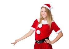 Christmas woman with hand presentation Stock Image