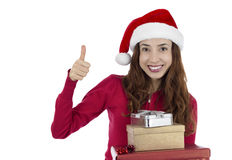 Christmas woman happy with her gifts giving thumbs up Stock Photo