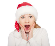 Christmas woman in a hat shock, surprise isolated on white Stock Photo