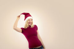 Christmas woman having fun. Pretty woman with christmas hat Royalty Free Stock Photography