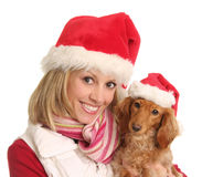 Christmas woman and her dog. Stock Photography
