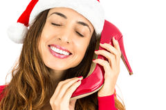 Christmas woman with her red shoes for christmas gift Royalty Free Stock Image