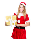 Christmas woman and hold with big golden gift box Royalty Free Stock Image