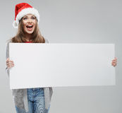 Christmas woman hold big white card. Santa hat.  Stock Photo