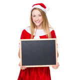 Christmas woman hold with chalkboard Royalty Free Stock Photos