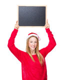 Christmas woman hold up with blackboard Stock Photo