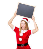 Christmas woman hold up with blackboard Royalty Free Stock Photos