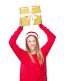Christmas woman hold up gift box Royalty Free Stock Photos