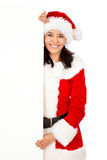 Christmas woman holding an add Royalty Free Stock Photography