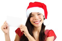 Christmas woman holding blank paper sign Royalty Free Stock Photo