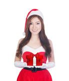 Christmas woman holding christmas gifts smiling Stock Photos