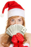 Christmas woman holding dollars banknotes Stock Photography
