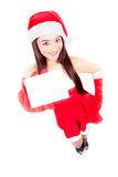Christmas woman holding empty sign Stock Photo