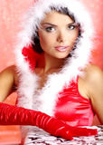 Christmas woman holding gift box Stock Photos