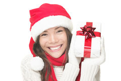 Christmas woman holding gift smiling Royalty Free Stock Image