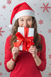 Christmas woman holding gifts. Christmas Santa hat  woman portrait hold christmas gift. Smiling happy girl stock photos