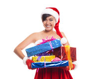Christmas woman holding gifts wearing Santa hat.Iisolated on whi Royalty Free Stock Photos