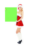 Christmas woman holding green blank banner Stock Photography