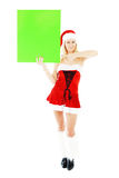 Christmas woman holding green blank banner Royalty Free Stock Image