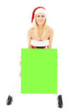 Christmas woman holding green blank banner Stock Image