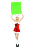 Christmas woman holding green blank banner Stock Photo