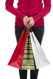Christmas woman holding her paper shopping gift bags Royalty Free Stock Photo