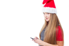 Christmas woman holding mobile phone Royalty Free Stock Photos
