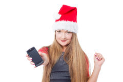 Christmas woman holding mobile phone Stock Images