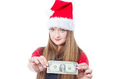 Christmas woman holding one dollar. Christmas woman wearing santa hat and holding money - isolated on white background Stock Photos