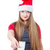 Christmas woman holding one dollar. Christmas woman wearing santa hat and holding money - isolated on white background Stock Photo
