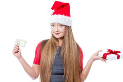 Christmas woman holding one dollar and gift box Royalty Free Stock Photography
