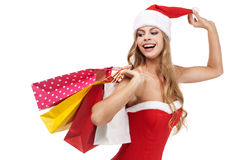 Christmas woman holding a shopping bags Royalty Free Stock Image
