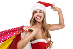 Christmas woman holding a shopping bags Stock Image