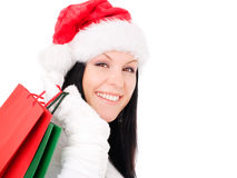 Christmas woman holding shopping bags over white Stock Photos