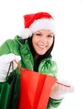 Christmas woman holding shopping bags over white Royalty Free Stock Image
