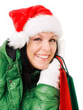 Christmas woman holding shopping bags over white Royalty Free Stock Photos