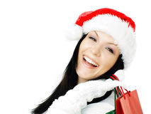 Christmas woman holding shopping bags over white Stock Image
