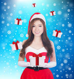 Christmas woman holding Something smiling Stock Image