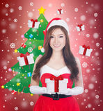 Christmas woman holding Something smiling Royalty Free Stock Photo
