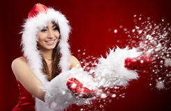 Christmas woman holding star Stock Images