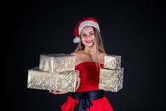 Christmas woman holding xmas or new years presents isolated Royalty Free Stock Photos