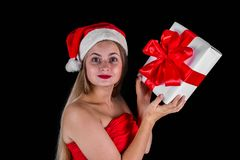 Christmas woman holding xmas or new years presents isolated. On black Royalty Free Stock Image