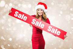 Christmas - Woman holds hands: Board on Sale subtitle Royalty Free Stock Photo